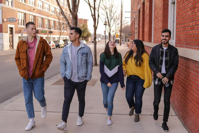 A group of students walking down a street