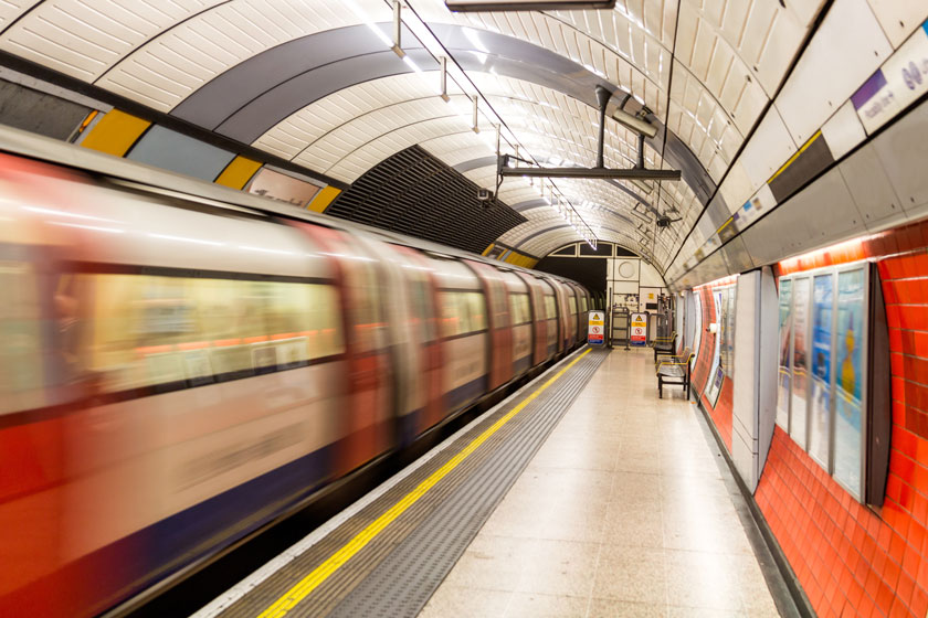 London Tube train going past a station