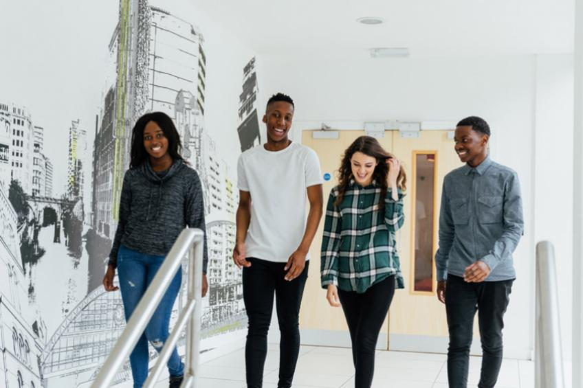 Students walking through a Sanctuary Students accommodation building.