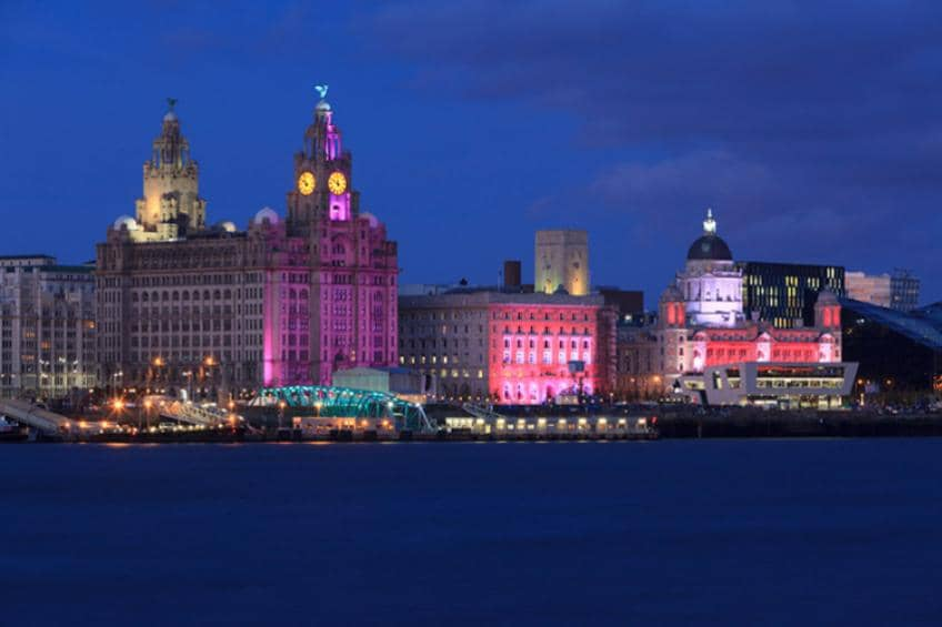 A cityscape of Liverpool at night.