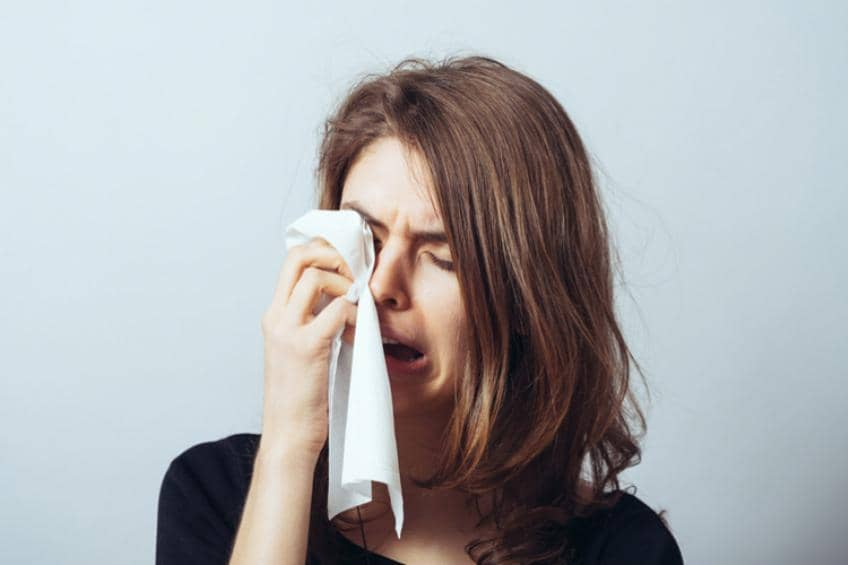 Female student wiping her tears.