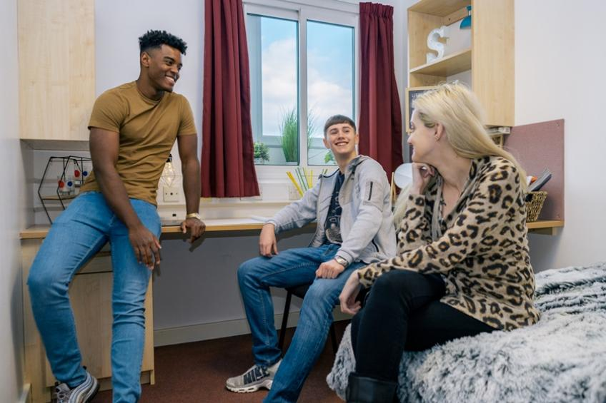Students in a student room socialising