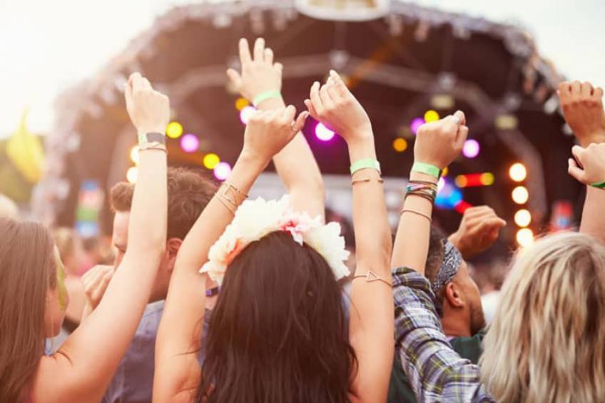 Revelers enjoy a music festival.