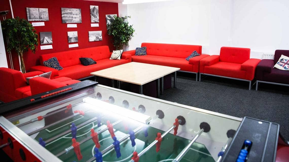 The common room at Alliance House with sofas and table football
