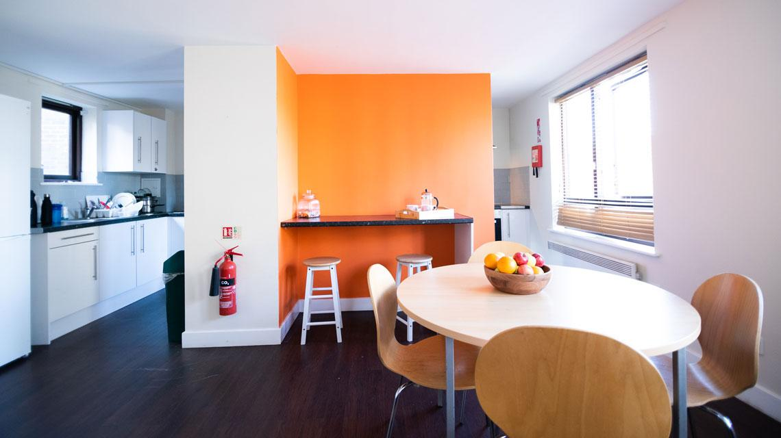 Example shared kitchen and dining area at Coopers Court, London