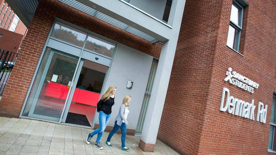 Two students walking out of Denmark Road