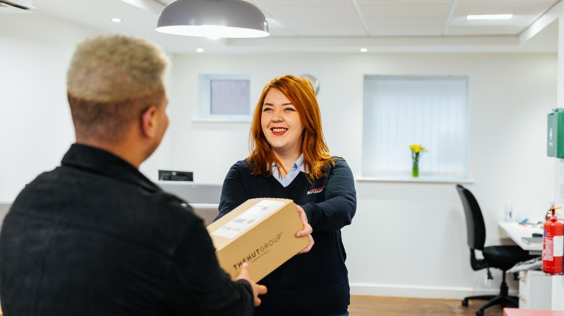 A student collecting a parcel at Moor Lane Halls
