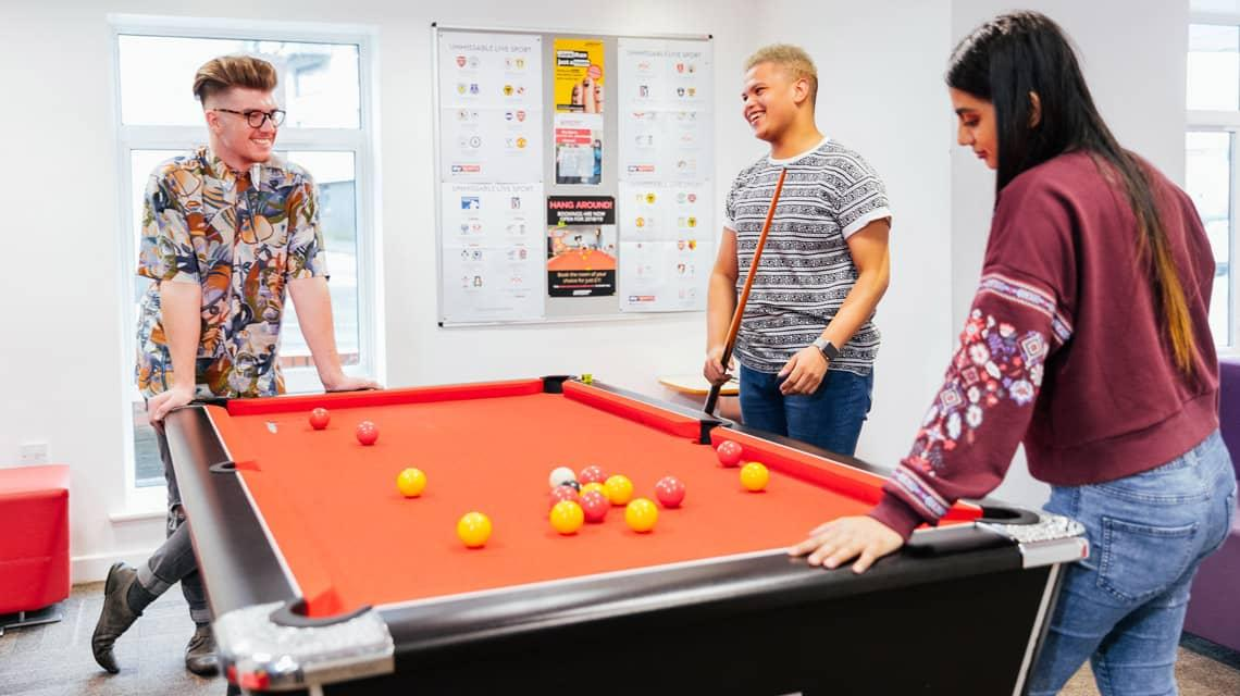 Students playing pool in the Moor Lane Halls common room
