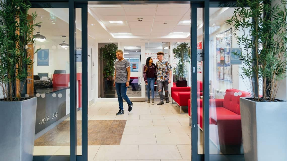 Students in the Moor Lane Halls reception area