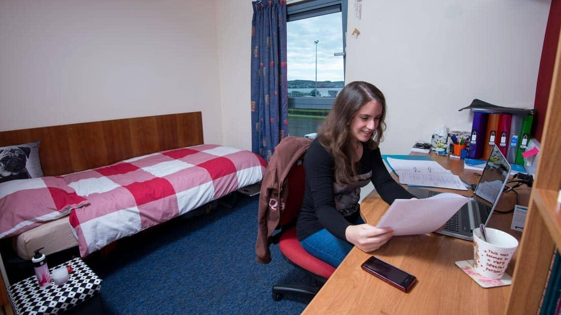 Student studying in a typical Seabraes bedroom