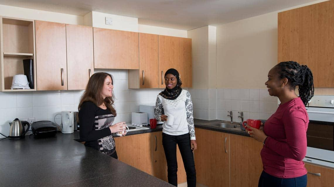 Students talking in an example Seabraes shared kitchen