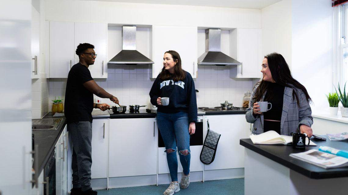 Students chatting in their communal kitchen