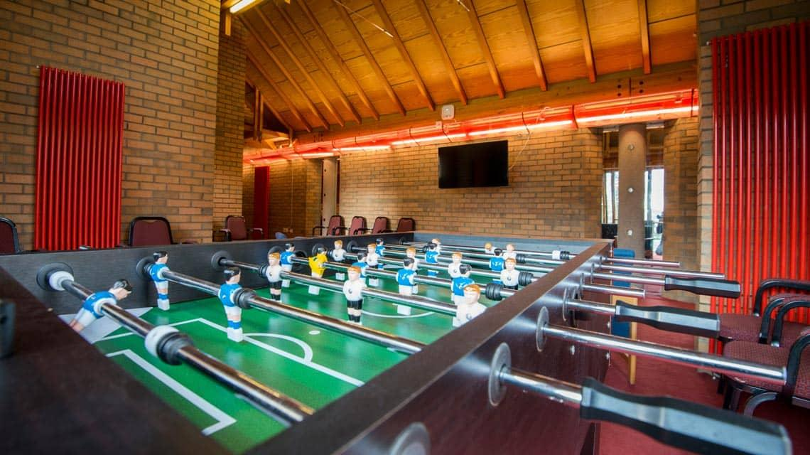 Table football in the common area at West Park Villas and Flats
