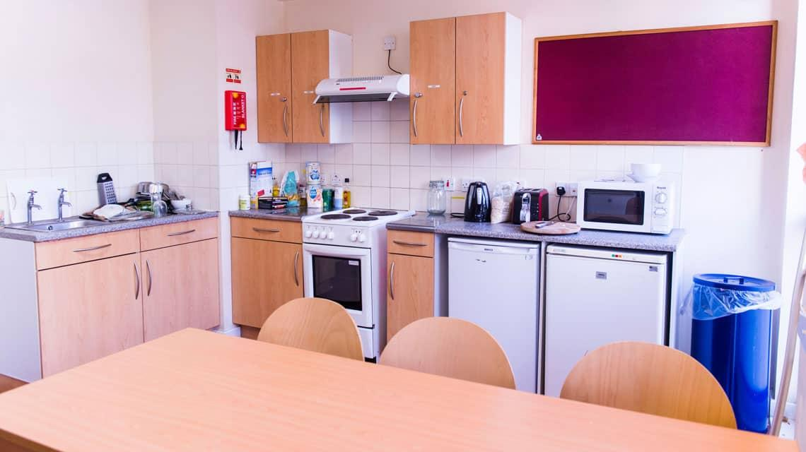 example shared kitchen and dining area at Don Gratton House