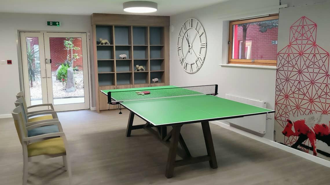 A table tennis table in the Lilian Knowles common room.