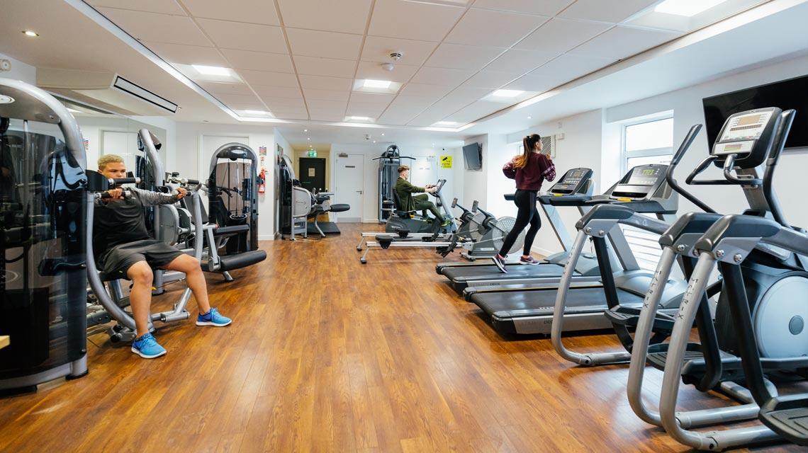 Students using the on-site gym at Moor Lane Halls