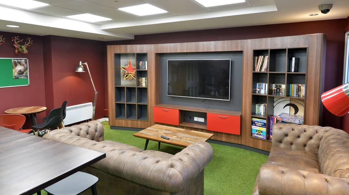 TV area within the Wardley House common room in Bradford