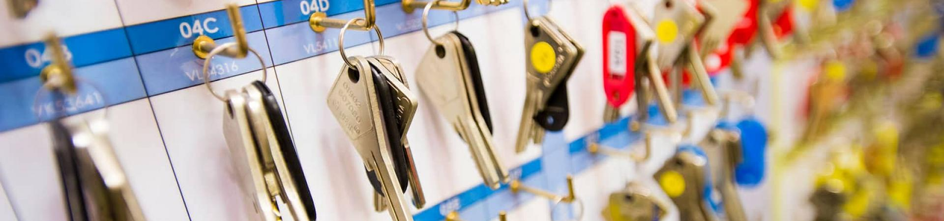 A selection of room keys hanging on the wall