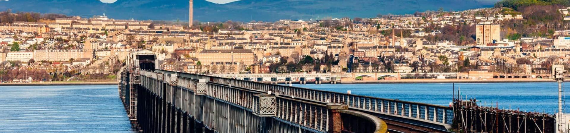 wide image of Dundee and the Tay railway Bridge