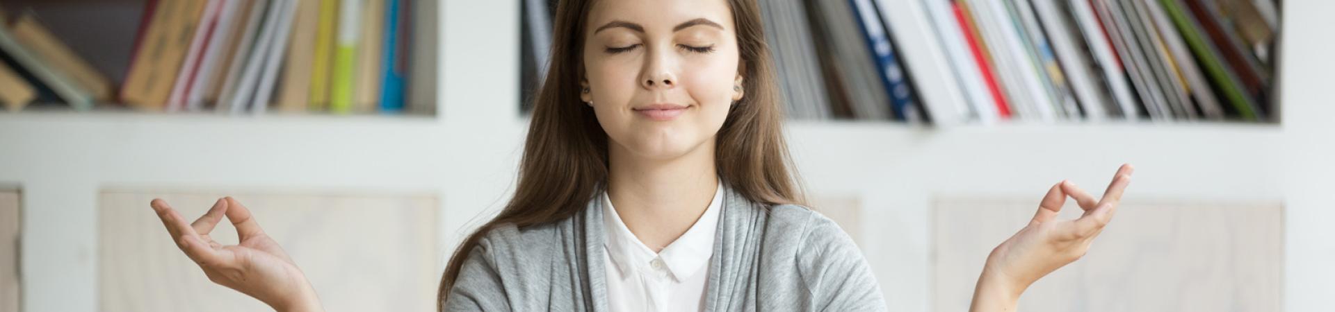 A student meditating.